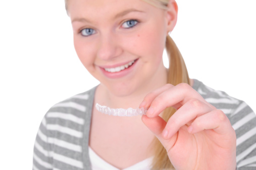 a smiling teen patient with Invisalign from Sawrie Orthodontics